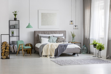 Green and silver spacious bedroom