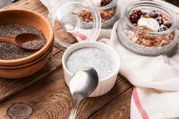 breakfast with chia, yoghurt and granola on a wooden table