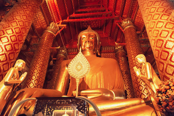 Giant golden Buddha in Wat Phanan Choeng Temple in Ayuthaya Thailand