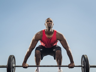 Black man preparing for lifting barbell