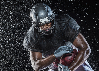Water splashing on football player