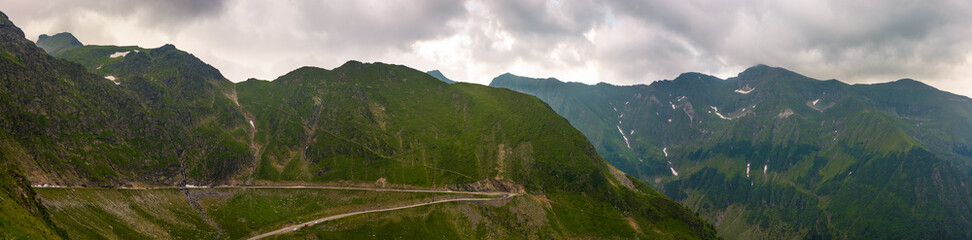 panorama of Fagaras mountains on a cloudy day. beautiful summer landscape with famous Transfagarasan road