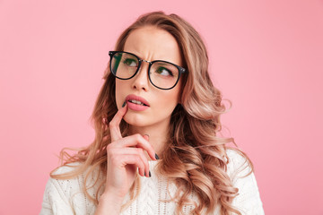 Pretty thinking lady over pink background