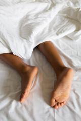 Girls feet in bed