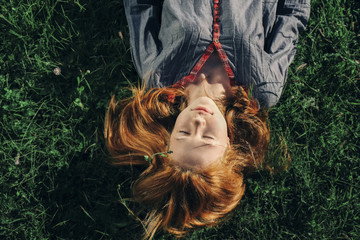 Overhead view of girl laying in the grass