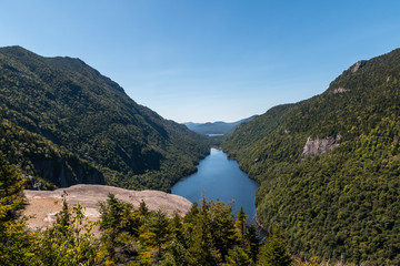 A deep blue lake surrounded by the Adirondack Mountains.