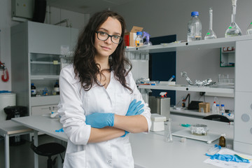 Woman in whites standing in lab