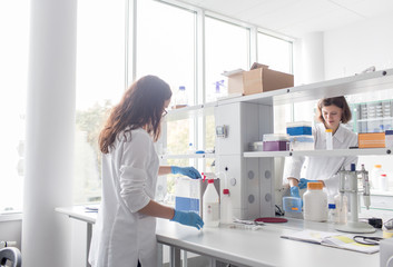 Women standing and working in lab