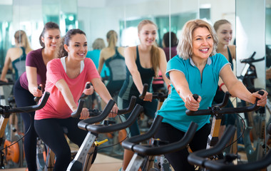 Females cycling in sport club .