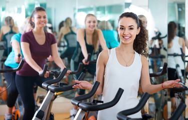 girl and other females working out in sport club