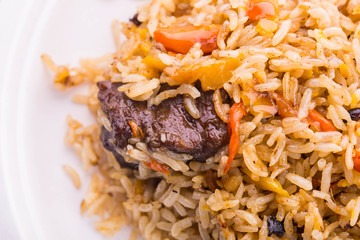 Meat pilaf with pieces of carrots and pepper