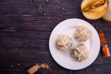 Dumplings with meat, pepper and fried onions