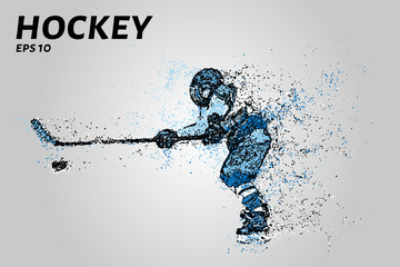 Hockey player of the particles. Silhouette of a hockey player consists of points