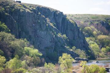 Beautiful landscape. Hills, trees, river, rocks