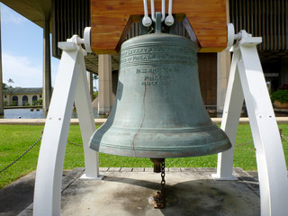 Close-up of Liberty Bell in front of the Hawaii State Capitol