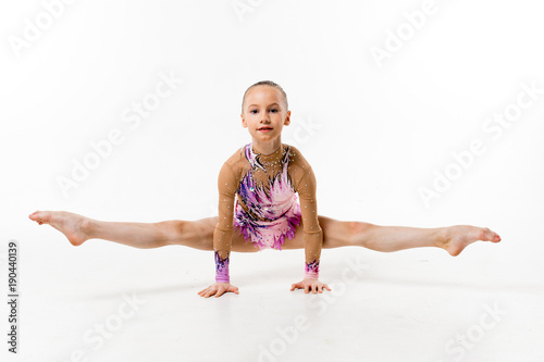 15139804b A young teenage girl in leotard shows gymnastic and ballet exercises ...