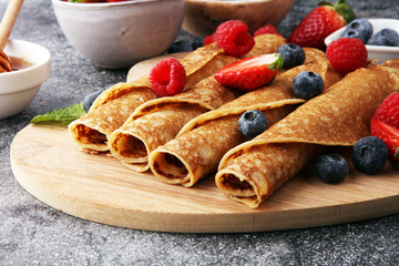 Delicious Tasty Homemade crepes or pancakes with raspberries and blueberries