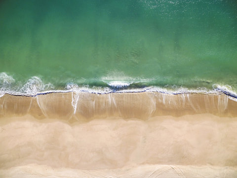 High angle scenic view of waves splashing on shore at beach