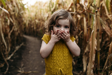 Portrait of girl standing in field