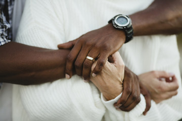 Midsection of man holding woman's hands
