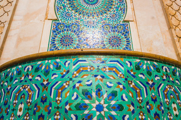 ow angle view of moroccan traditional water tap decorated with colorful shapes of mosaic