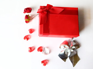 Box with gift with decorative heart on white background. Romantic background. Valentine's Day background.
