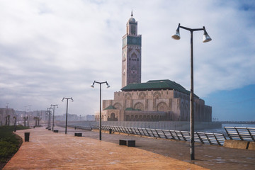 View of Hassan II mosque from the park in a cloudy day - Casablanca - Morocco
