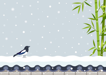 Bamboo with magpie on snowy Korean traditional brick wall.Korean Traditional Happy New Year Day