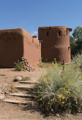 Exterior of Old Adobe, Earthen Wall Tower Against Blue Sky