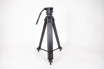 black camera tripod on white background