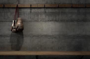 Worn Vintage Boxing Gloves Hanging In Change Room