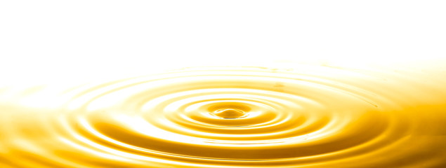 Liquid gold drop and ripple ,abstract background