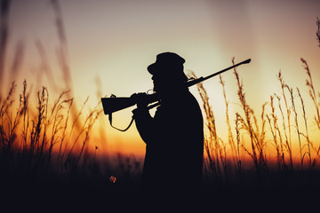 Silhouette of hunter at sunrise