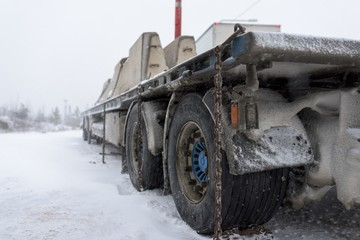 Truck carrying concrete blocks in winter parked
