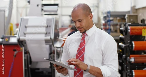 4K Successful business manager in print factory working on