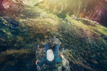 Hiking Man Sitting On Cliff Bridge Edge With Mountains Aerial View Travel Lifestyle Adventure Vacations Concept