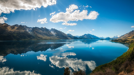 Sun rays at Lake Wakatipu from the scenic road from Queenstown to Glenorchy, New Zealand, South Island