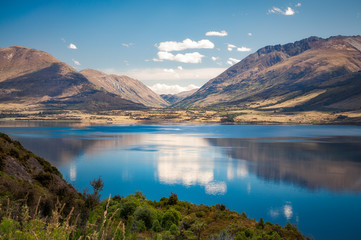 The calm waters of Lake Wakatipu in summer, New Zealand, South Island