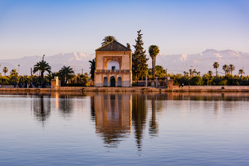 Foto op Aluminium Marokko Saadian pavilion,Menara gardens and Atlas in Marrakech, Morocco, Africa