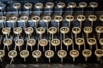 old typewriter keyboard close-up - vintage antique style typewriter