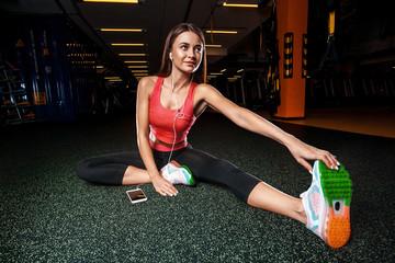 sporty girl in a cross-training gym