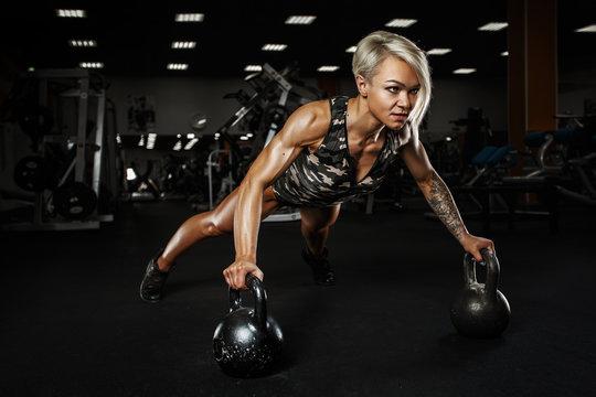 Sexy sporty girl. Sporty girl on training hall.
