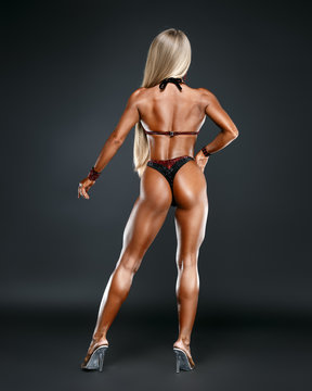 sporty girl on black background