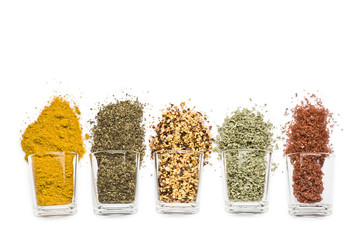 Photo sur Toile Herbe, epice glass jars with various spices on white background with copy space
