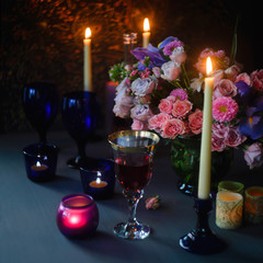 Candles wine and roses