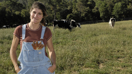 portrait of a woman farmer with some cows