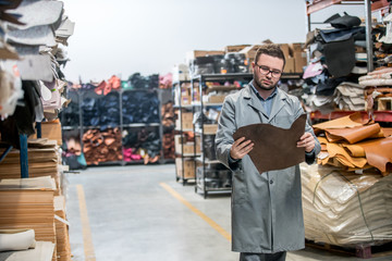 business manager at leather shoe factory doing various daily tasks