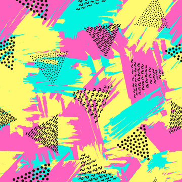 Colorful seamless pattern from triangles on the bright brush strokes background. 80's - 90's years design style.