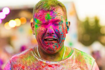 Guy with celebrate holi festival
