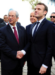 Tunisian Parliament president Mohamed Ennaceur greets French President Emmanuel Macron at the Tunisian Parliament in Tunis
